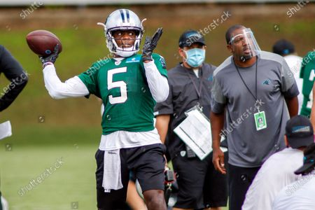 Carolina Panthers quarterback Teddy Bridgewater (5) throws a pass during NFL football training camp in Charlotte, N.C. With stalwarts like Cam Newton, Greg Olsen, Luke Kuechly and Trai Turner all leaving Carolina, the Panthers are the only team with less than half of snaps last season returning, At least new quarterback Teddy Bridgewater has some familiarity with offensive coordinator Joe Brady's system, having spent the 2018 season together in New Orleans