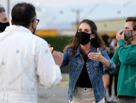 "Alison Brie, center, a cast member in ""The Little Hours,"" mingles with cast member Fred Armisen before a screening of the film presented by ArcLight Cinemas at the Vineland Drive-In theater, in Industry, Calif. In the background are writer/director Jeff Baena, left, and cast member Dave Franco, right"