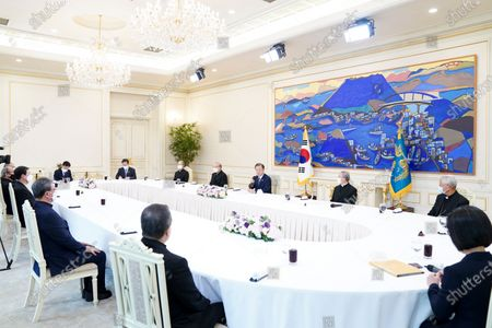 South Korean President Moon Jae-in (C) speaks during a meeting with Catholic Church leaders, including Cardinal Andrew Yeom Soo-jung, over a luncheon at the presidential office in Seoul, South Korea, 20 August 2020.