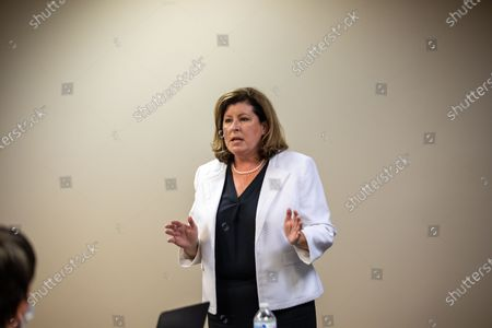 Former Congresswoman Karen Handel holds a training for volunteers in Sandy Springs, Georgia for knocking doors and making voter contacts.