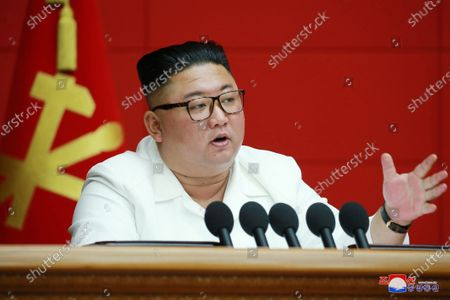 Kim Jong-un, chairman of the Workers' Party of Korea, chairman of the State Affairs Commission of the Democratic People's Republic of Korea and supreme Commander of the armed forces of the DPRK speaks during the 6th Plenary Meeting of the 7th Central Committee of the Workers' Party of Korea at the office building of the Central Committee of the Party, the supreme general staff of the Korean revolution