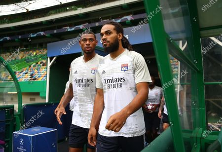 Jason Denayer of Olympique Lyon (R) and Jeff Reine-Adelaide of Olympique Lyon (L) walk out to warm up prior to the UEFA Champions League Semi Final match between Olympique Lyonnais and Bayern Munich at Estadio Jose Alvalade on August 19, 2020 in Lisbon, Portugal.