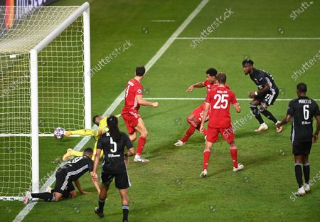 Serge Gnabry of Bayern Munich scores his team's second goal past Anthony Lopes of Olympique Lyonnais during the UEFA Champions League Semi Final match between Olympique Lyonnais and Bayern Munich at Estadio Jose Alvalade on August 19, 2020 in Lisbon, Portugal.
