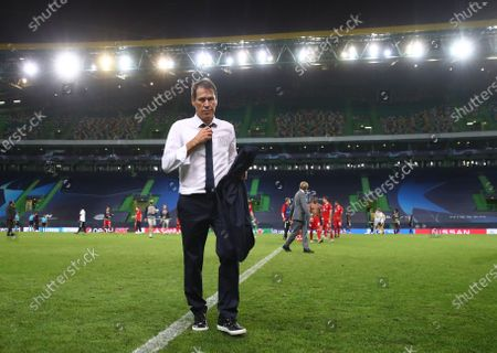 Stock Picture of Rudi Garcia, Head Coach of Olympique Lyonnais looks dejected following his sides defeat in the UEFA Champions League Semi Final match between Olympique Lyonnais and Bayern Munich at Estadio Jose Alvalade
