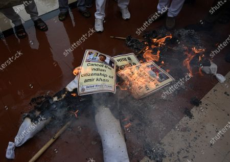 Stock Picture of Members of United Hindu Front burn an effigy of Bollywood actor Aamir Khan to protest against his visit to Turkey, at Hindu Mahasabha, Mandir Marg, on August 19, 2020 in New Delhi, India.
