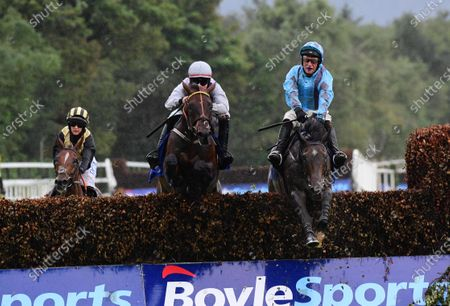 Killarney ANYTHING WILL DO & J.J.Slevin (right) jump the last to win the Kelly Brothers Beginners Steeplechase from DO YA FEEL LUCKY & James O'Sullivan (left)