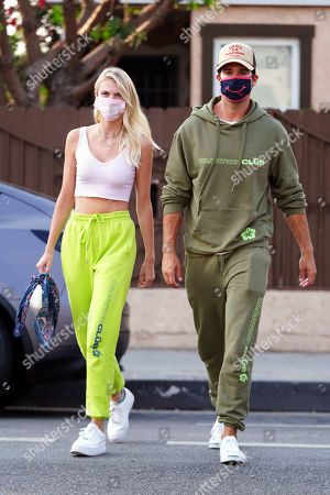 Caitlin Spears and James Maslow cross the street
