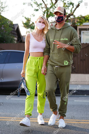Stock Photo of Caitlin Spears and James Maslow cross the street