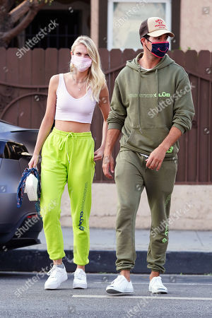 Stock Image of Caitlin Spears and James Maslow cross the street