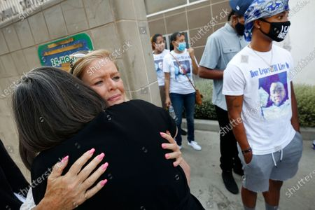 Los Angeles City Councilwoman Monica Rodriguez, left, hugs Ronnell Kelly, Mother of 18-year-old Michael Kelly who was shot to death in February 2019 in Pacoima. Rodriguez comforted members of three families who had family members killed by possible gang members while non of the victims were gang members themselves. Three $50,000 rewards are being offered as the Los Angeles Police Department held a press conference outside the Foothill Station to seek the public help in solving the three separate fatal shootings in Pacoima. Los Angeles on Wednesday, Aug. 19, 2020 in Pacoima, CA. (Al Seib / Los Angeles Times