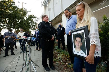 Ronnell and Randy Kelly, parents of 18-year-old Michael Kelly who was shot to death in February 2019 in Pacoima with Lt Jim Gavin during a press conference for three families who had family members killed by possible gang members while non of the victims were gang members themselves. Three $50,000 rewards are being offered as the Los Angeles Police Department held a press conference outside the Foothill Station to seek the public help in solving the three separate fatal shootings in Pacoima. Los Angeles on Wednesday, Aug. 19, 2020 in Pacoima, CA. (Al Seib / Los Angeles Times