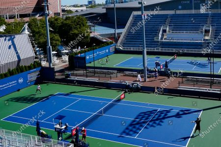 Players practice at the USTA Billie Jean King National Tennis Center before the start of the Western & Southern Open tennis tournament, in New York