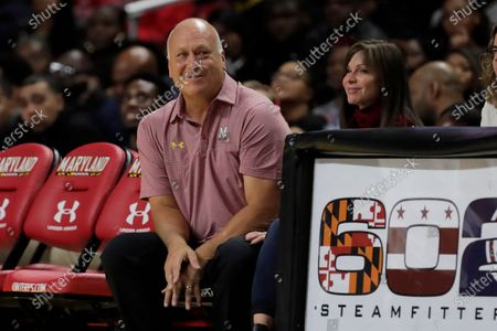 Stock Image of Hall of Fame Baltimore Orioles shortstop Cal Ripken Jr., left, sits with his wife Laura S. Kiessling, Anne Arundel County, Md., circuit court judge, during the second half of an NCAA college basketball game between Maryland and Rhode Island, in College Park, Md. Cal Ripken Jr. revealed Thursday that he underwent surgery for prostate cancer in March and is now completely healthy