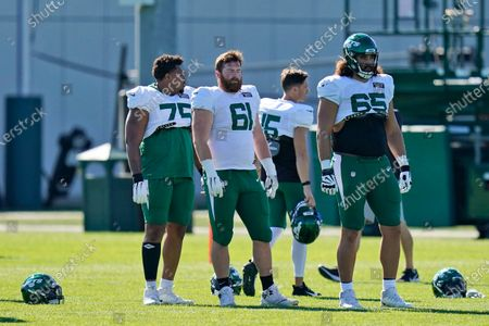 New York Jets' Chuma Edoga, left, and James Murray, center, and Corbin Kaufusi participate during practice at the NFL football team's training camp in Florham Park, N.J