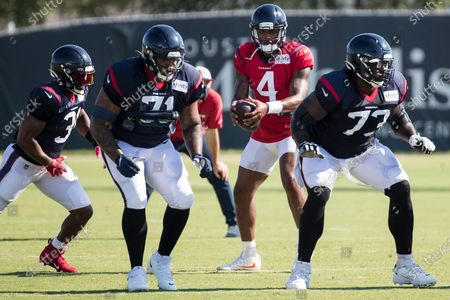 Houston Texans quarterback Deshaun Watson (4) drops back to run a play with running back David Johnson (31) during an NFL training camp football practice, in Houston