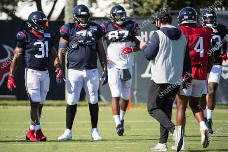 Houston Texans running back David Johnson (31), tackle Tytus Howard (71), tight end Darren Fells (87) and quarterback Deshaun Watson (4) gather up to huddle during NFL football training camp, in Houston