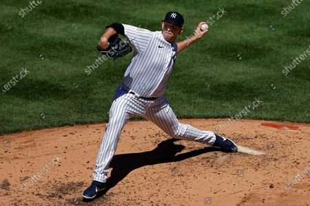 Stock Picture of New York Yankees pitcher James Paxton delvers a pitch against the Tampa Bay Rays during the third inning of a baseball game, in New York