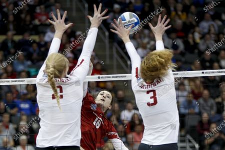 Stock Image of Wisconsin's Dana Rettke (16) has a spike blocked by Stanford's Holly Campbell (3) and Kate Formico (11) during the NCAA Division I women's volleyball championship match in Pittsburgh. Athletes in sports other than football say they were not surprised to see the Big Ten and Pac-12 conferences postpone fall sports until the spring. Even though they will continue training, some wonder if it will be possible to play or whether the coronavirus will cancel their seasons as well