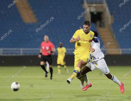 Al-Nassr player Ahmed Musa (R) in action with Al-Taawoun player Ricardo Machado (L) during the Saudi Professional League soccer match between Al-Taawoun and Al-Nassr, in Buraidah, Saudi Arabia, 20 August 2020.