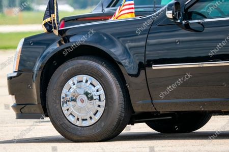 """President Donald Trump rides in the heavily armored limousine known as """"the beast"""" which rolls on specially-made Goodyear tires, at Joint Base Andrews in Suitland, Md., . Trump is urging people not to buy tires from Goodyear amid claims that the Ohio-based manufacturer has banned his MAGA campaign hats"""