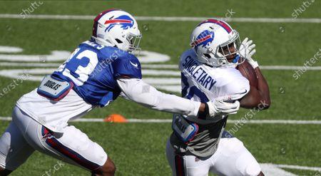 Buffalo Bills running back Devin Singletary right, beats linebacker Del'Shawn Phillips, for a short gain during NFL football training camp in Orchard Park, N.Y