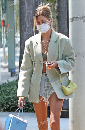 Stock Image of Hailey Bieber is seen after shopping at Anita Ko in West Hollywood