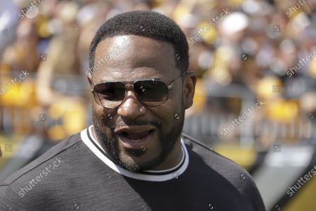 Stock Image of Former Pittsburgh Steelers running back Jerome Bettis watches the Steelers play against the Seattle Seahawks in the first half of an NFL football game, in Pittsburgh. The Hall of Fame running back has filed a racial discrimination lawsuit against a Pittsburgh company he had promoted for its commitment to diversity
