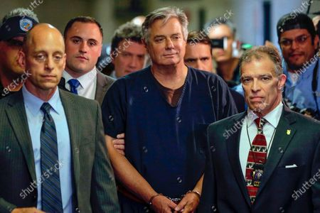 Paul Manafort, center, arrives at court in New York. The arrest of President Donald Trump's former chief strategist Steve Bannon adds to a growing list of Trump associates ensnared in legal trouble. They include the president's former campaign chair, Manafort, whom Bannon replaced, his longtime lawyer, Michael Cohen, and his former national security adviser, Michael Flynn