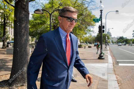 Michael Flynn, President Donald Trump's former national security adviser, leaves the federal court following a status conference in Washington. The arrest of President Donald Trump's former chief strategist Steve Bannon adds to a growing list of Trump associates ensnared in legal trouble. They include the president's former campaign chair, Paul Manafort, whom Bannon replaced, his longtime lawyer, Michael Cohen, and his former national security adviser, Michael Flynn