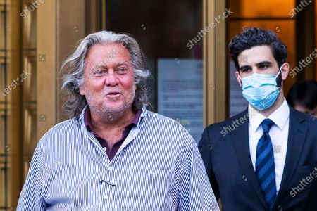 President Donald Trump's former chief strategist Steve Bannon exits court after pleading not guilty to charges that he ripped off donors to an online fundraising scheme to build a southern border wall, in New York