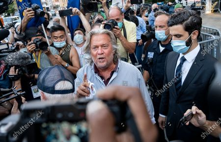 President Donald Trump's former chief strategist Steve Bannon leaves federal court, after pleading not guilty to charges that he ripped off donors to an online fundraising scheme to build a southern border wall