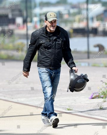 Chris Gascoyne with motorcycle helmet at the ITV Studios at Salford Quays