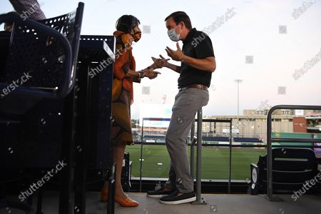 Rep. Rosa DeLauro, D-Conn, left, talks with Sen. Chris Murphy, D-Conn., right, during a watch party for the Democratic National Convention at Dunkin' Donuts Park, home of the Hartford Yard Goats minor league baseball team, in Hartford, Conn