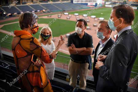 Rep. Rosa DeLauro, D-Conn, left, speaks as Annie Lamont, wife of Gov. Ned Lamont, second from left, State Attorney General William Tong, center, Connecticut Gov. Ned Lamont, second from right, and Sen. Richard Blumenthal, D-Conn., listen during a watch party for the Democratic National Convention at Dunkin' Donuts Park, home of the Hartford Yard Goats minor league baseball team, in Hartford, Conn