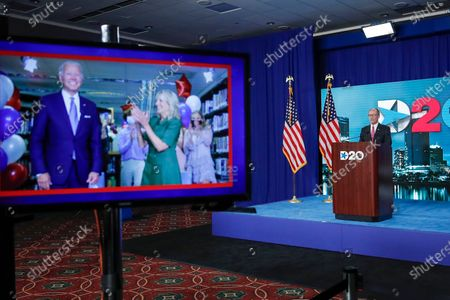 Democratic National Committee Chairman Tom Perez addresses the final night of the virtual 2020 Democratic National Convention, as Democratic presidential candidate former Vice President Joe Biden and Jill Biden are shown on a video, left, in Milwaukee, Wisc