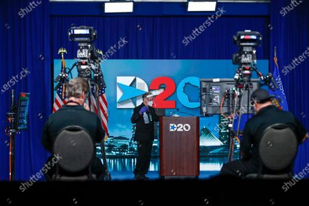 A member of the staff cleans the stage after Chairman of the Democratic National Committee Tom Perez spoke during day four of the virtual Democratic National Convention in Milwaukee, Wisconsin, USA, 20 August 2020. Thursday marked the last day of the Democratic National Convention, which is being held virtually for the first time in history.