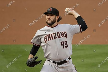 Arizona Diamondbacks pitcher Alex Young works against the Oakland Athletics in the first inning of a baseball game, in Oakland, Calif