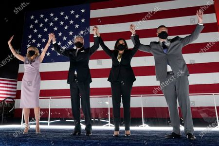 Democratic presidential candidate former Vice President Joe Biden, and his wife Jill Biden, join Democratic vice presidential candidate Sen. Kamala Harris, D-Calif., and her husband Doug Emhoff, during the fourth day of the Democratic National Convention, at the Chase Center in Wilmington, Del