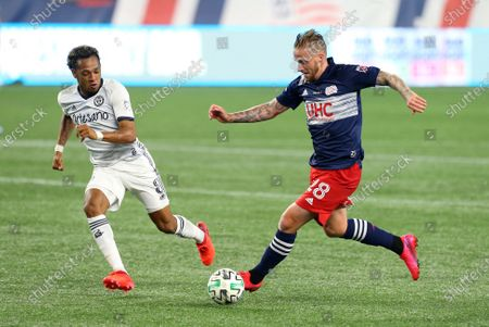 Foxborough, MA, USA; New England Revolution defender Alexander Buttner (28) and Philadelphia Union midfielder Jose Andres Martinez (8) in action during a MLS match between Philadelphia Union and New England Revolution at Gillette Stadium