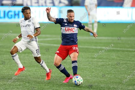 Stock Image of Foxborough, MA, USA; New England Revolution defender Alexander Buttner (28) and Philadelphia Union midfielder Jose Andres Martinez (8) in action during a MLS match between Philadelphia Union and New England Revolution at Gillette Stadium