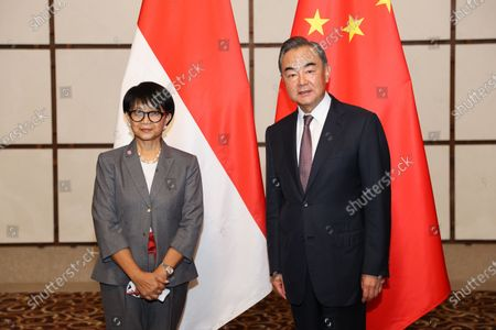 Chinese State Councilor and Foreign Minister Wang Yi holds talks with Indonesian Foreign Minister Retno Marsudi in Baoting Li and Miao Autonomous County, south China's Hainan Province, Aug. 20, 2020.