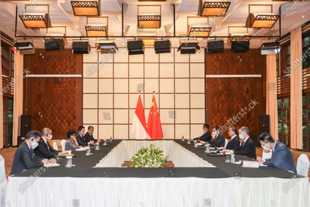 Chinese State Councilor and Foreign Minister Wang Yi holds talks with Indonesian Foreign Minister Retno Marsudi in Baoting Li and Miao Autonomous County, south China's Hainan Province, Aug. 20, 2020. Indonesian Minister for State-owned Enterprises Erick Thohir also attended the talks.