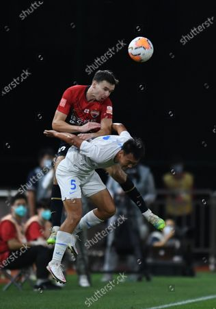 Stock Picture of Ole Selnaes (above) of Shenzhen Jiazhaoye vies with Wu Wei of Dalian Yifang during the 6th round match between Shenzhen Jiazhaoye and Dalian Yifang at the postponed 2020 season Chinese Football Association Super League (CSL) Dalian Division in Dalian, northeast China's Liaoning Province, Aug. 20, 2020.