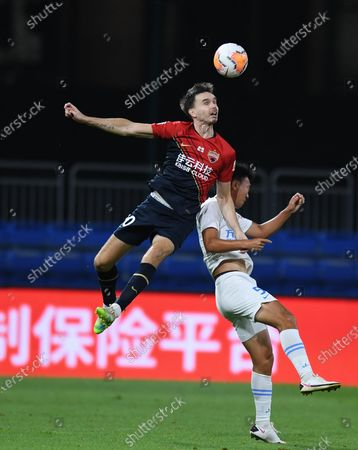 Stock Photo of Ole Selnaes (above) of Shenzhen Jiazhaoye vies with Wu Wei of Dalian Yifang during the 6th round match between Shenzhen Jiazhaoye and Dalian Yifang at the postponed 2020 season Chinese Football Association Super League (CSL) Dalian Division in Dalian, northeast China's Liaoning Province, Aug. 20, 2020.
