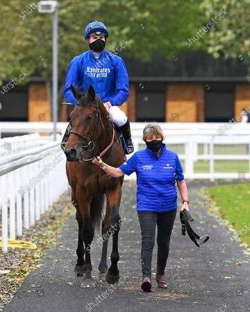 Winner of The Baverstock Nursery Stakes Soft Whisper ridden by Hector Crouch and trained by Saeed bin Suroor is led into the Winners enclosure during Horse Racing at Salisbury Racecourse on 21st August 2020