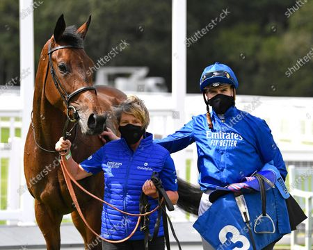 Stock Picture of Winner of The Baverstock Nursery Stakes Soft Whisper ridden by Hector Crouch and trained by Saeed bin Suroor in the Winners enclosure during Horse Racing at Salisbury Racecourse on 21st August 2020