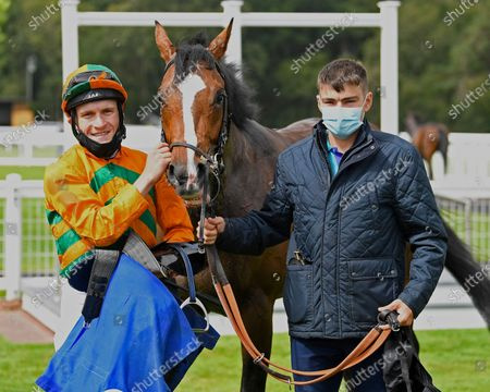 Stock Picture of Winner of The Dinton Handicap (Div 1)   Old News (Orange) ridden by Finlay Marsh and trained by Richard Hughes in the Winners enclosure during Horse Racing at Salisbury Racecourse on 21st August 2020