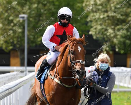 Winner of The Pitton Handicap Stakes Just Glamorous ridden by Nicola Currie and trained by Christopher Mason is led into the Winners enclosure during Horse Racing at Salisbury Racecourse on 21st August 2020