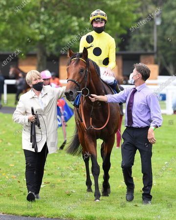 Winner of The Odstock Handicap Postileo ridden by David Egan and trained by Roger Varian is led into the Winners enclosure during Horse Racing at Salisbury Racecourse on 21st August 2020