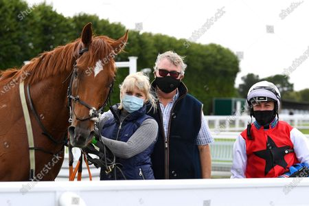Stock Picture of Winner of The Pitton Handicap Stakes Just Glamorous ridden by Nicola Currie and trained by Christopher Mason in the Winners enclosure during Horse Racing at Salisbury Racecourse on 21st August 2020